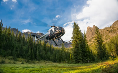 A research helicopter comes in to landing at a remote grizzly bear study site in the Rocky Mountains of British Columbia (Photo: Clayton Lamb, PhD Student 2014-)