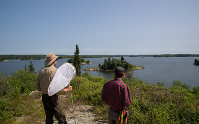 Graduate student Zac and field technician Ira take a breather while conducting insect surveys on lake islands in Ontario (Photo: Scott Nielsen)